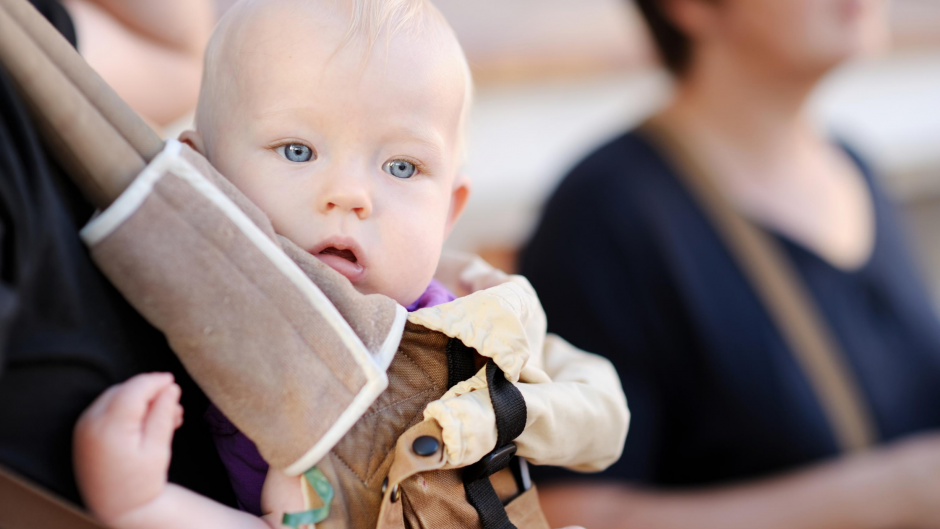 Baby being worn in a baby carrier