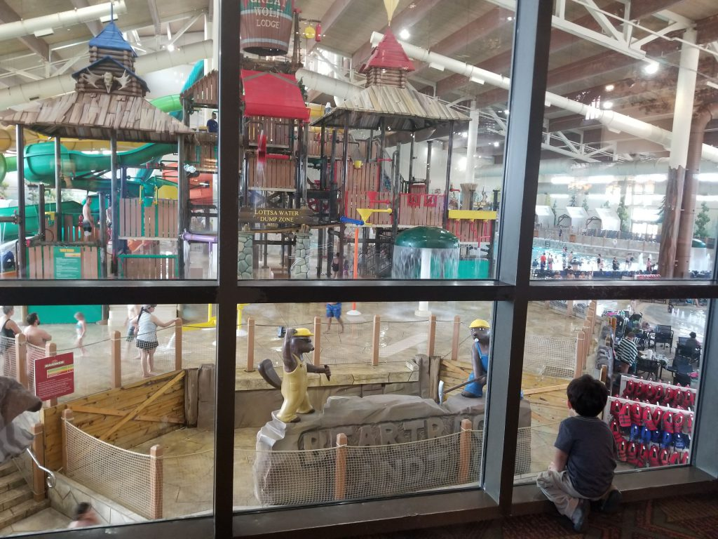 Child looking out over the slides at Great Wolf Lodge in Dallas