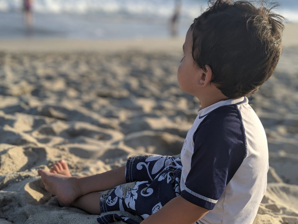 Boy sitting on the beach