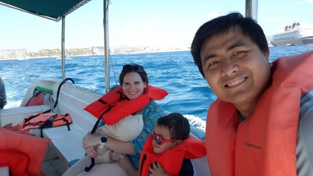 Family in a glass-bottom boat in Los Cabos