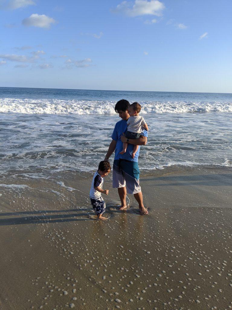 Man and kids on the beach near Hyatt Ziva Los Cabos