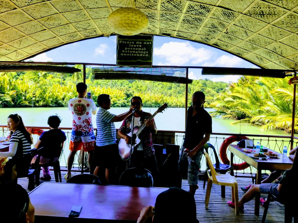 Musicians playing on the Loboc River Cruise