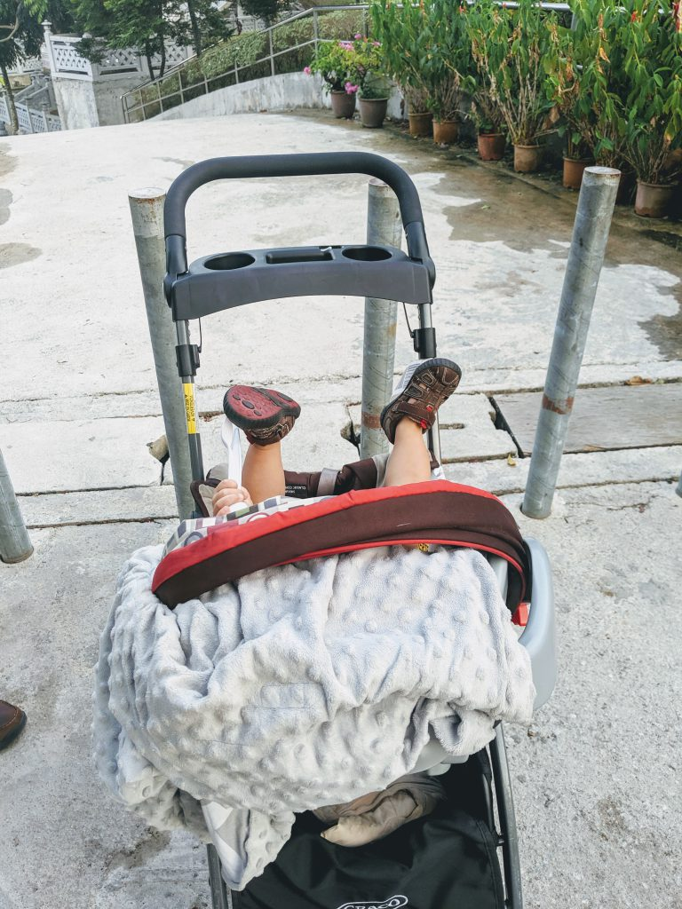 A baby in a stroller at Kek Lok Si Temple in Penang, Malaysia