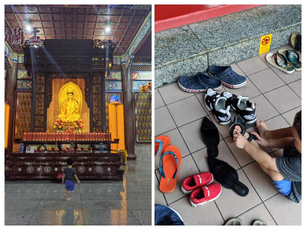 A boy removing his shoes outside a temple at Kek Lok Si Temple in Penang, Malaysia