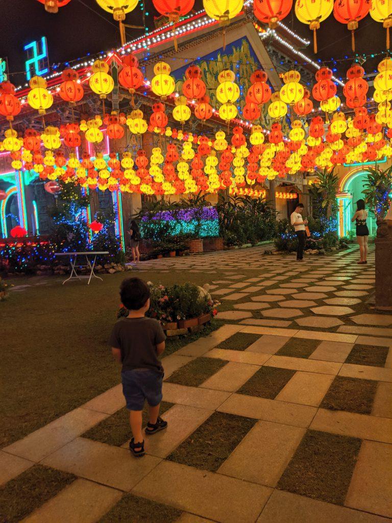 A courtyard in Kek Lok Si Temple lit with lanterns