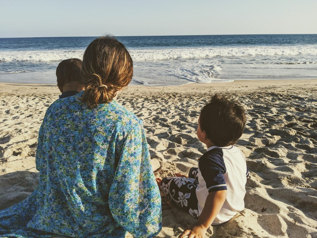 Woman and kids on the beach near Hyatt Ziva Los Cabos- best Cabo resorts for families