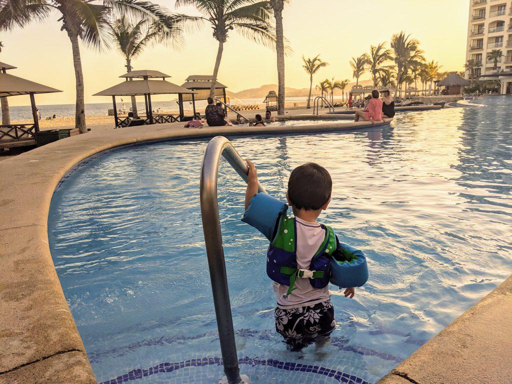 Boy in a pool at Hyatt Ziva Los Cabos