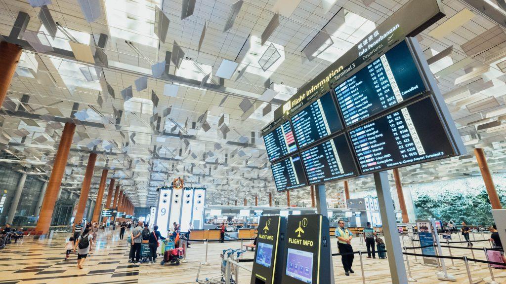 Flight status monitors in an airport terminal
