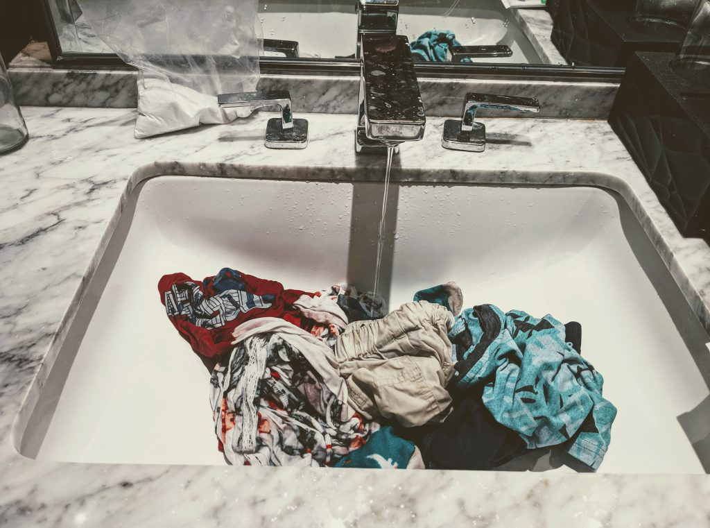 Traveling light by washing clothes in the sink in Italy