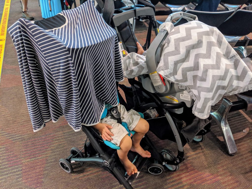 Two kids napping, one in a car seat frame stroller and one in a gB Pockit stroller