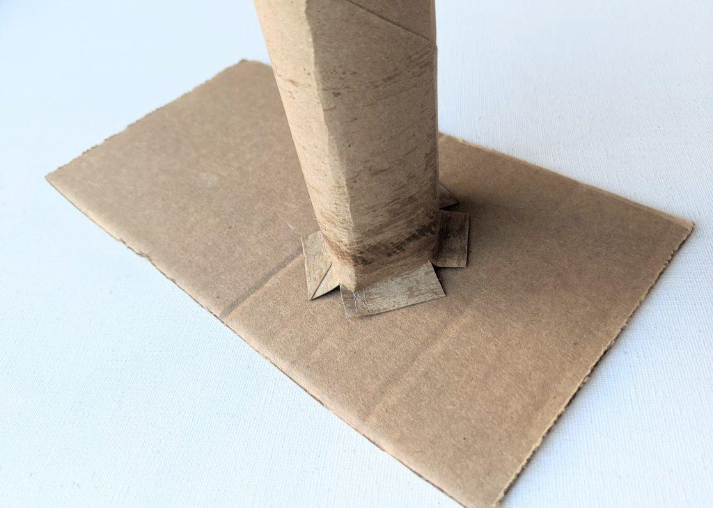 Base of paper towel roll glued to cardboard