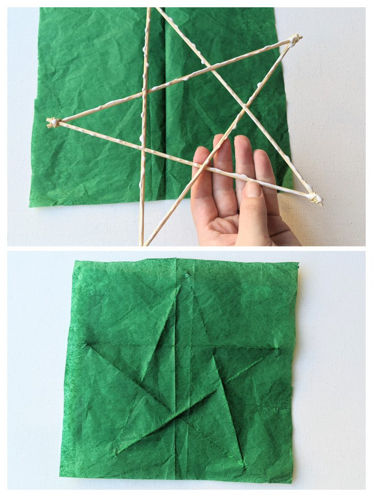 Gluing the wood star onto the tissue paper
