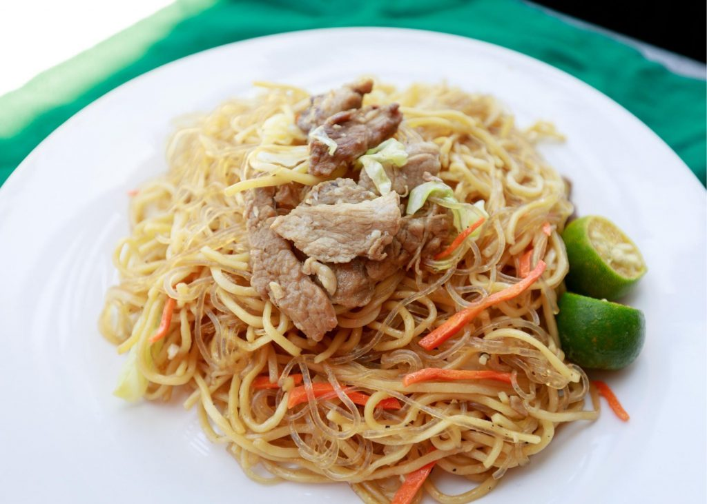 Pancit is a great food to try when visiting the Philippines with kids