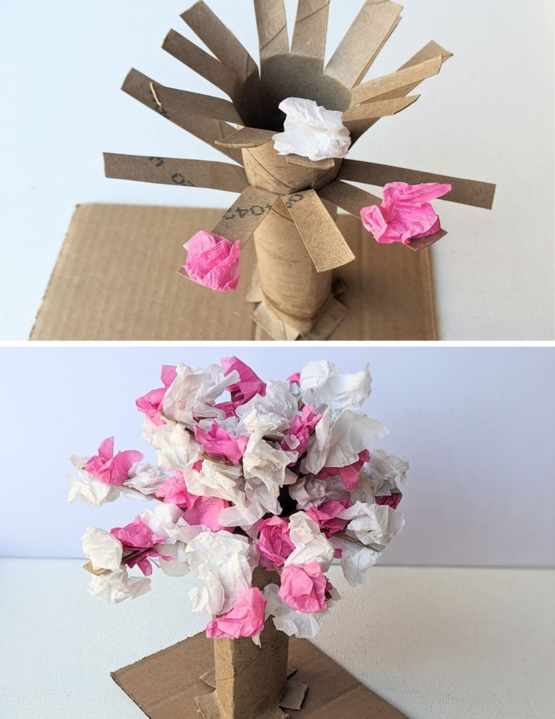 Putting tissue paper on the tree to make the cherry blossoms