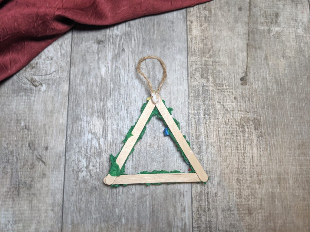 Glue a string loop to the back of the ornament
