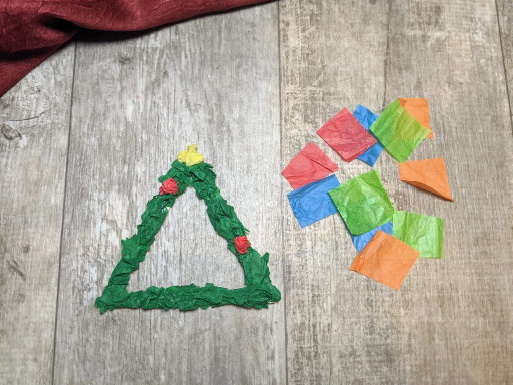 Use tissue paper to make a star and ornaments on the tree ornament