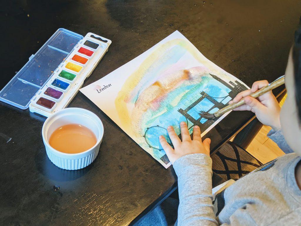 Preschooler painting his London city skyline printable