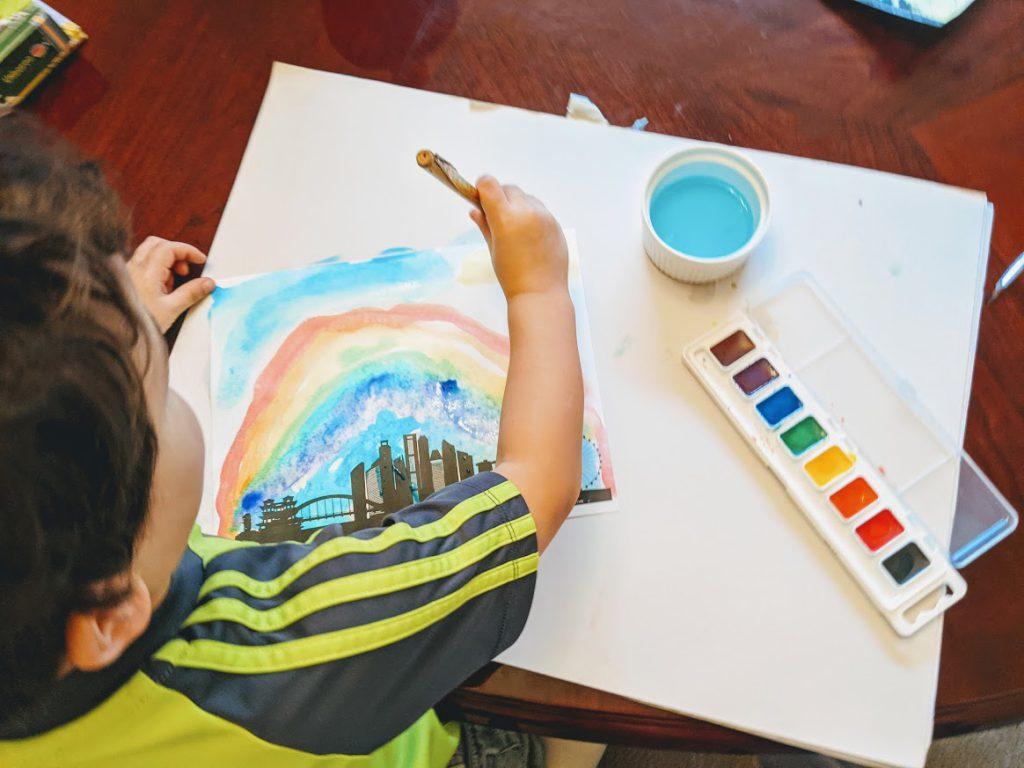 Preschooler painting a Singapore city skyline printable