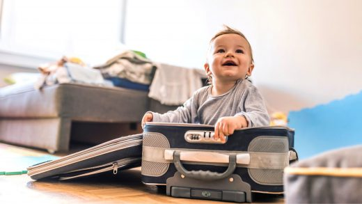 Baby in a suitcase for travel