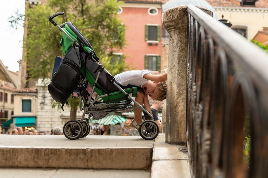 Child in a stroller in Venice Italy