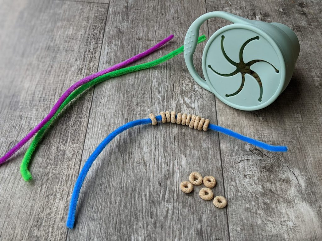 Cereal on a pipe cleaner- toddler airplane activities