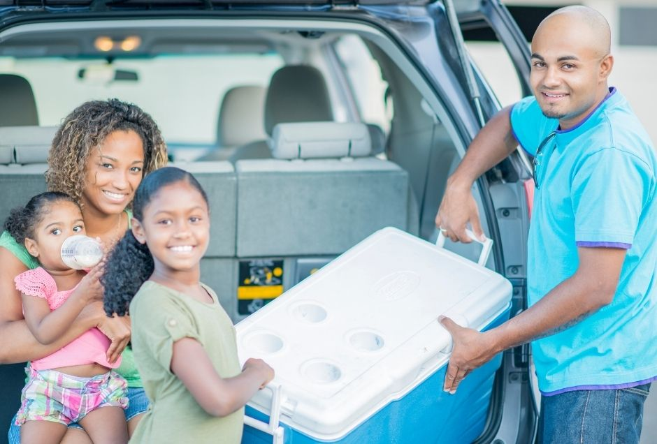 Family with a cooler of food