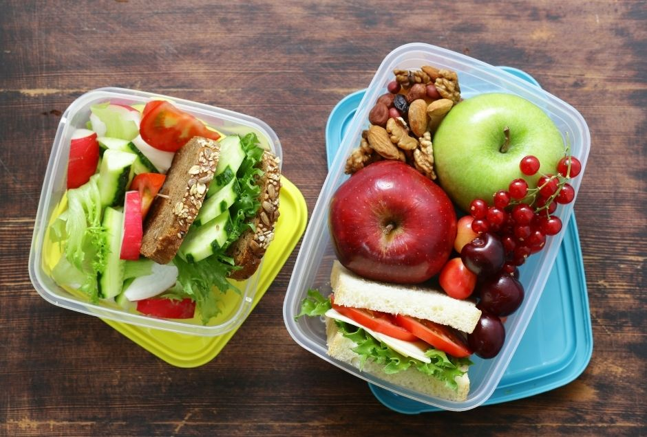 An assortment of lunch food packed in two containers