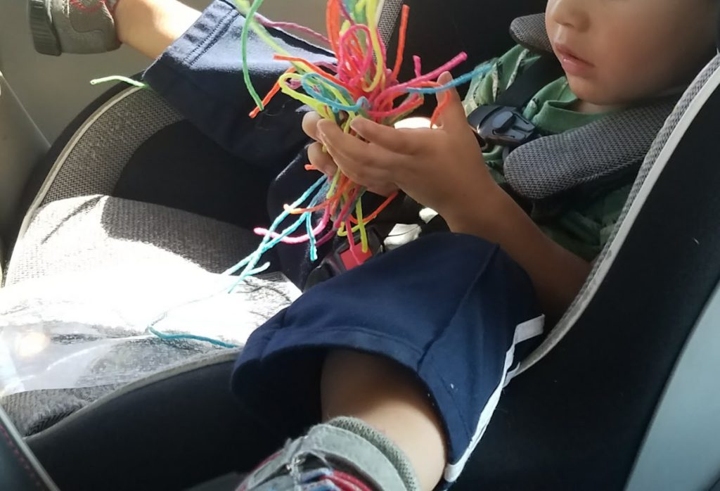 Toddler playing with a handful of Wiki Stix