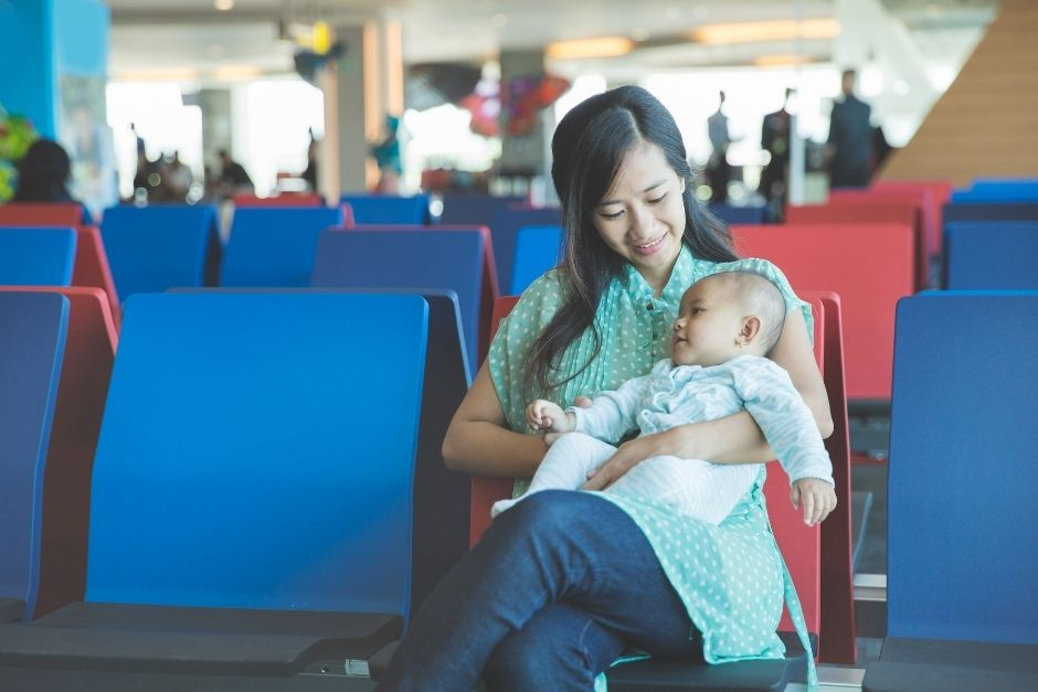 Woman and baby at the airport- first flight with baby