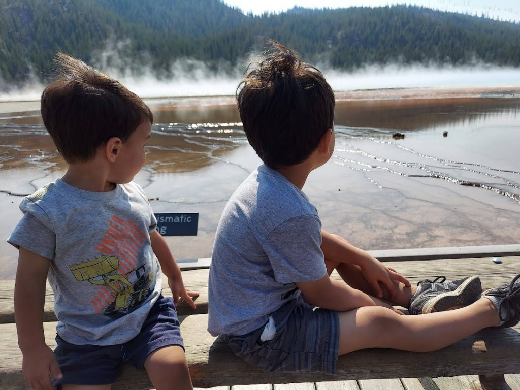 Kids looking out over Grand Prismatic Spring- 3 day Yellowstone itinerary