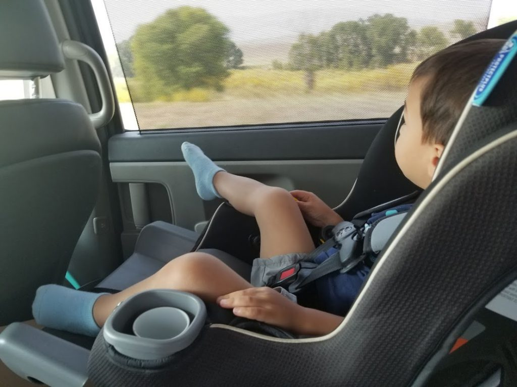 Child in a car seat- road trip with a toddler