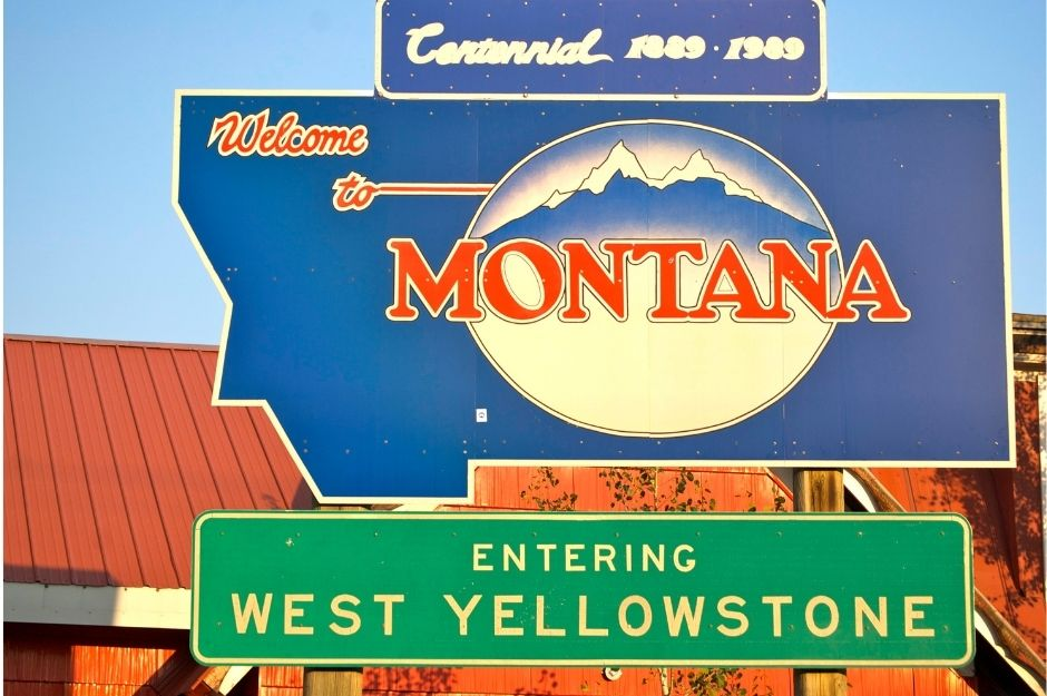 """A sign that says """"Welcome to Montana"""" and """"Entering West Yellowstone"""""""